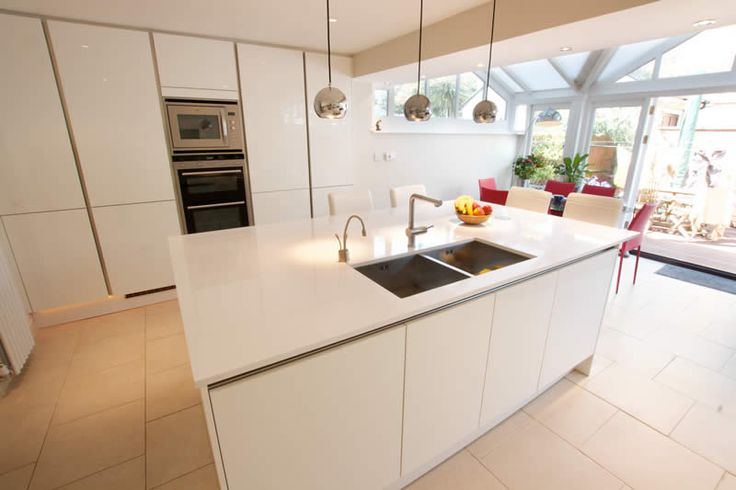 High Gloss kitchens from LWK Kitchens - High gloss white kitchen island design - Discover more at www.lwk-home.com