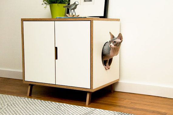 A mid-century modern cabinet used to disguise a litter box.