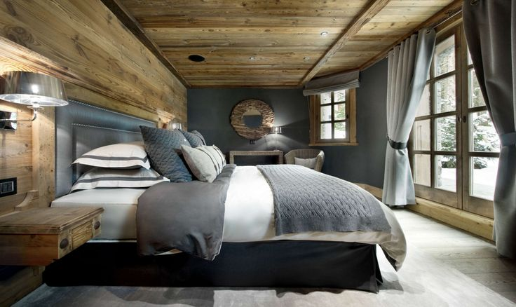 Intresting solution with massive wooden ceiling yet light floors. Great combination of grey textiles and warm wooden textures