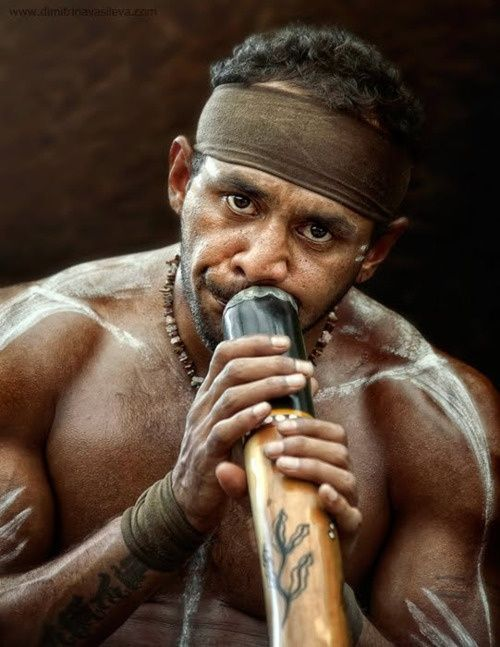 """Australianaborigine man playingthe didgeridoo (also known as a didjeridu) ~ a wind instrument developed by Indigenous Australians of northern Australia around 1,500 years ago and still in widespread use today both in Australia and around the world. It is sometimes described as a natural wooden trumpet or """"drone pipe"""" // http://www.youtube.com/watch?v=9g592I-p-dc"""