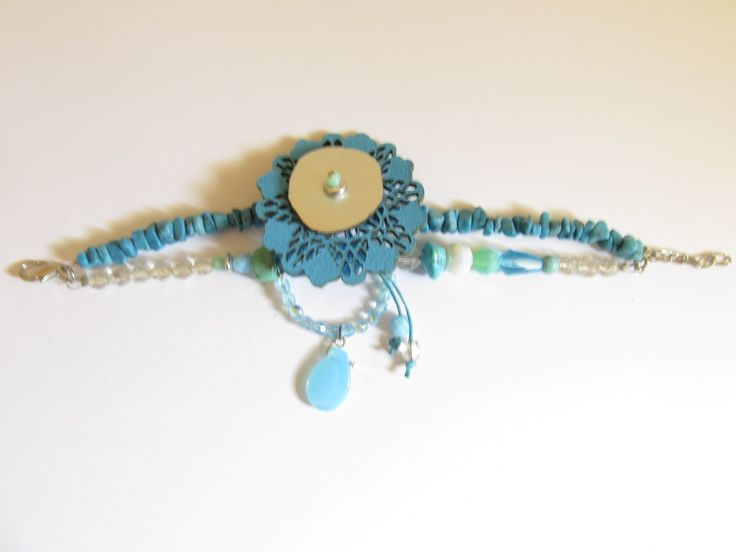Handmade leather bracelet (1 pc)  Made with turquoise laser cut leather filigree, glass beads and turquoise stones.