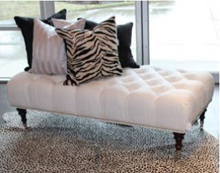 Button Tufted Ottoman featuring chrome nailheads and castors used as a ...