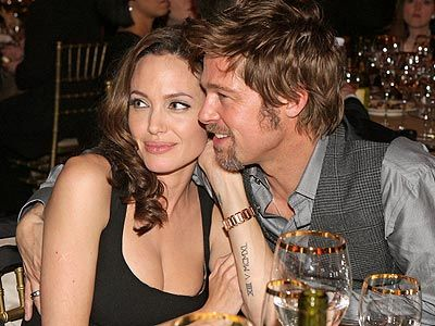 Brad Pitt & Angelina Jolie know how to pose