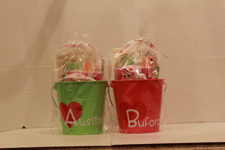 Goodie Tins for the Teachers. Spiced up some $1 tins from Target's $1 Hot Spot.  Personalized with vinyl heart and last names using my Cricut. Filled with a ton of goodies including a customized name stamp and custom Post It note holder.