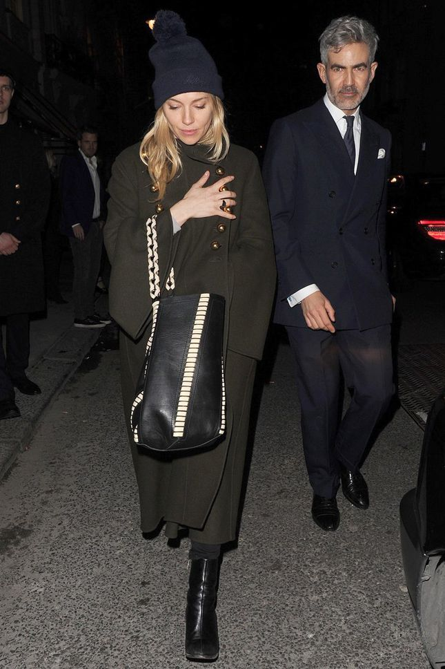 Sienna Miller in a Burberry coat, boots Dear Frances, and with a bag of Proenza Schouler in London