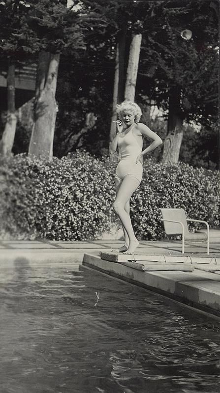 Never seen before photo of Jean Harlow by the pool at Dolores del Rio's home in Santa Monica, California.