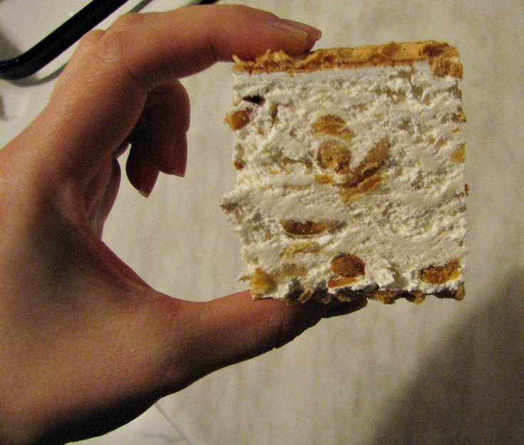 Törökméz (a sweet sticky white nougat paste cooked with sugar, eggwhites, honey, bits of walnuts, spread between two wafer sheets).