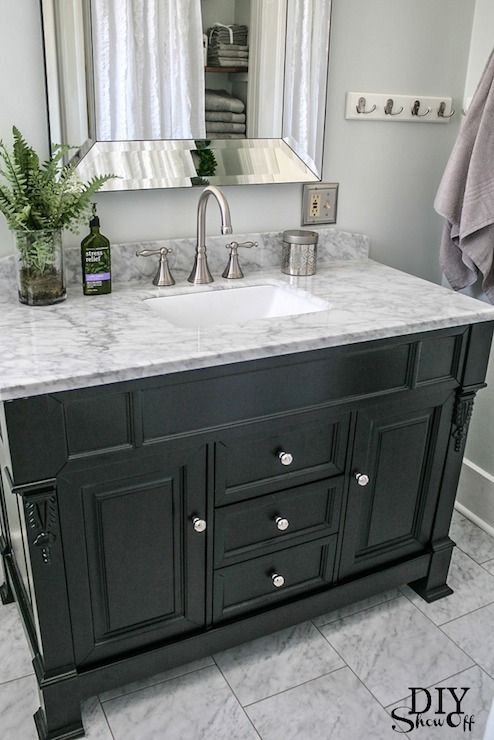 love the furniture look of this vanity, mirror, and Carrera marble counter-top