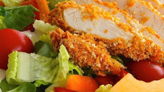 Chicken coated in Spicy Doritos(R) crumbs is a quick and easy weeknight dinner the whole family will love.