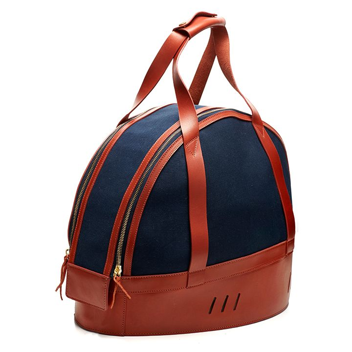 The TINCT Helmet Bag offers a unique solution to protect and transport your valuable motorcycle or motorsport helmet. We have worked closely with our factory in East London to createthis piece, which is entirely handmade, from the cutting of the materials, to the stitching. The bespokenature of its production means that we can work with you to create an entirely personalised item, selecting colourways and details to suit your needs. For more information or enquiries on pricing…