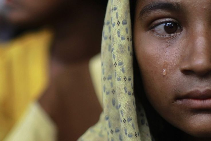 A Muslim woman, displaced by recent violence in Kyukphyu township, cries after arriving at the Thaechaung refugee camp outside of Sittwe Oct...