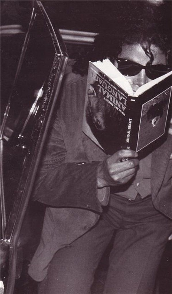 Michael Jackson (Joking around and reading an animal language book upside down) 1988