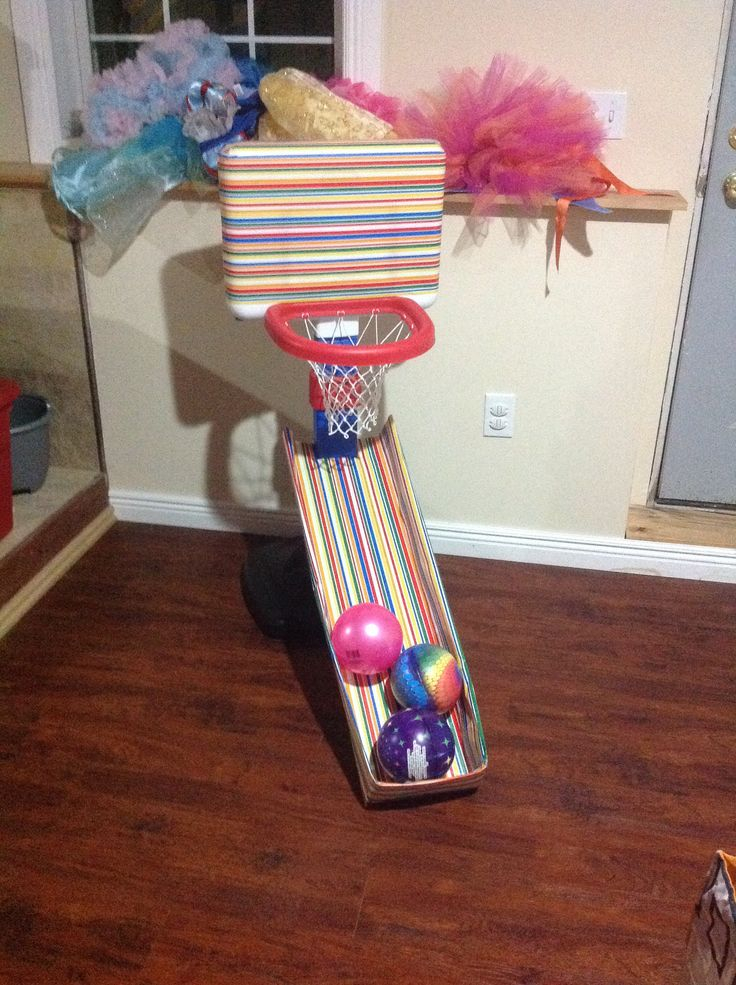 Catch trap for toddler basketball hoop, cardboard and gift wrap. Use fabric for longer use