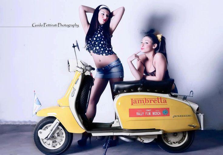 Yellow Lambretta with 2 Pin Up Girls