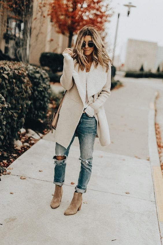 Cozy winter white shearling jacket with white tee and blue jeans.