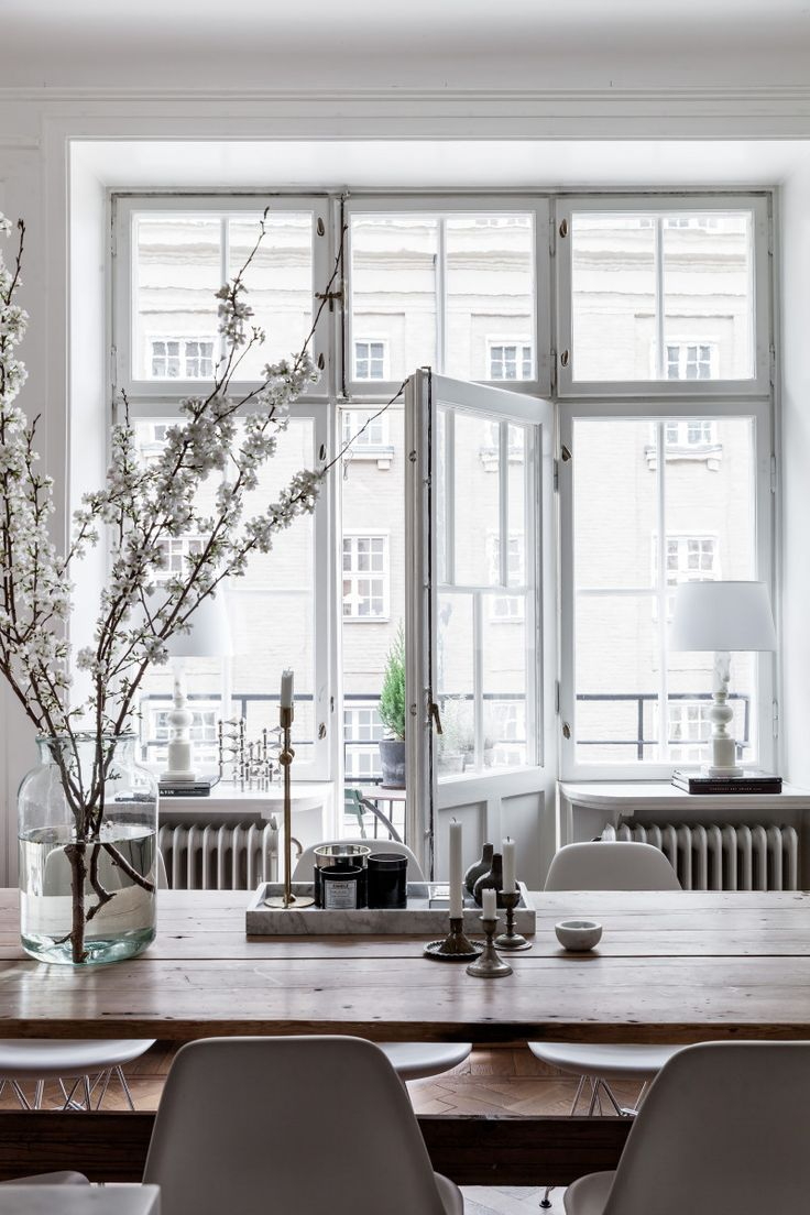 Lovely, clean dining area with blossom branches