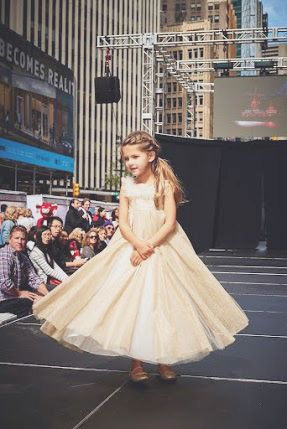Our little model catwalking like a princess in a gorgeous golden tulle dress #dress #tulle #catwalk #fashionshow #NYC