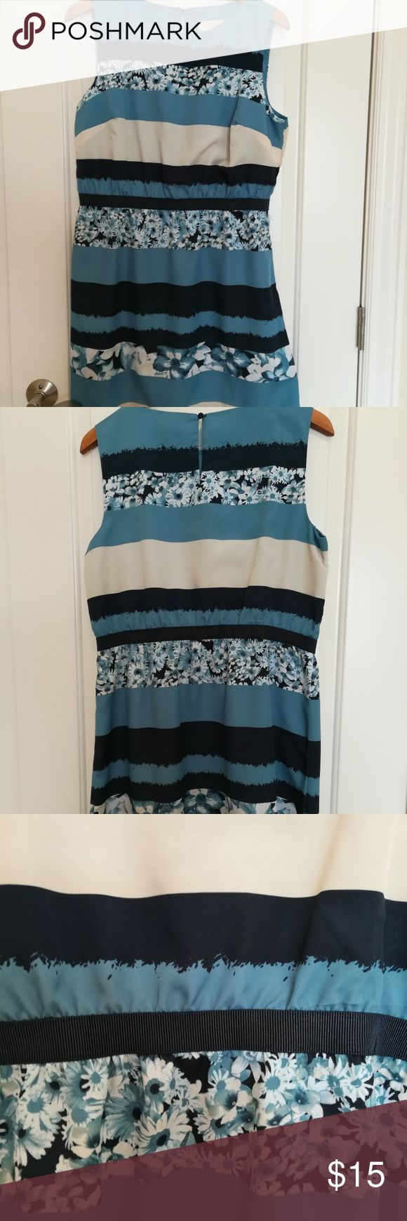 Loft Blue Strip with Floral Shift Dress Navy, cream and light blue stripes with floral. Great dress for spring and summer. The tag indicating what kind of fabric is missing. It has  silky feel to it. Gros grain ribbon waistline. Pre-owned good condition.  This is a petite dress size large length 34 inches LOFT Dresses Mini