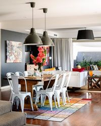 Dark floors, dark table, white chairs and Anna Chandler rug - perfection!