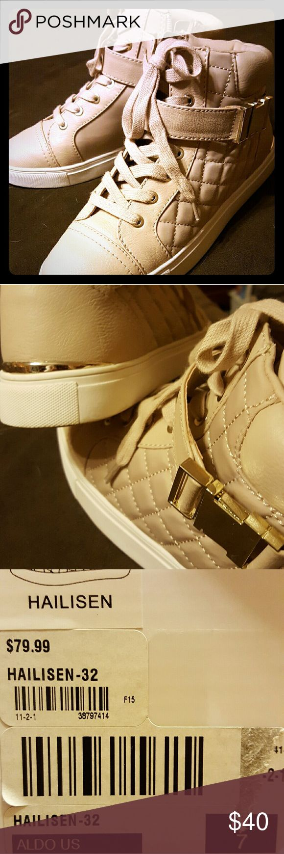 Ladies High Top sneakers Style and comfort all in one. Side zip with gold tone buckle and heel edge. Color is not well represented in picture, more of a blush peach. Only worn a couple of times. Like new condition. Aldo Shoes Sneakers