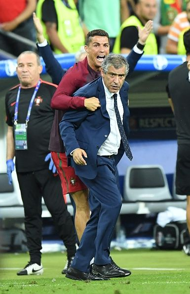 #EURO2016 Portugal's Cristiano Ronaldo and head coach of Portugal Fernando Santos are seen during the Euro 2016 final football match between Portugal and...