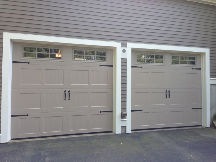 haas model steel carriage house style garage doors in sandstone with 6 pane glass u0026
