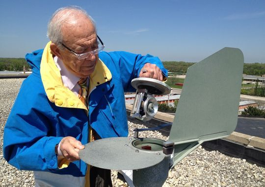 On May 13 in Melrose Park, Ill., retired allergist Joseph Leija shows the container holding a slide that records the mold and pollen of the past 24 hours. The air-sucking Burkard device sits atop the roof of the Gottlieb Memorial Hospital. Every weekday, Leija counts and identifies the spores from the slide using a microscope and reports his data to the public by 7 a.m. (Photo: Wendy Koch, USA TODAY)