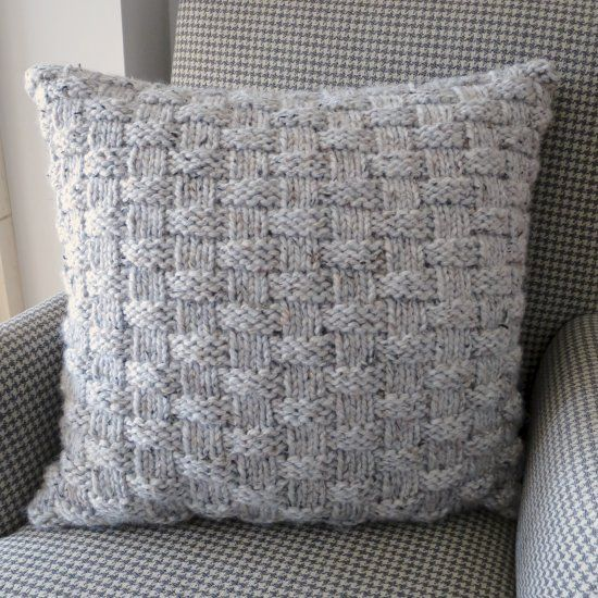 This basket weave throw pillow knits up quickly with super bulky yarn. Make one to cozy up your couch for winter.
