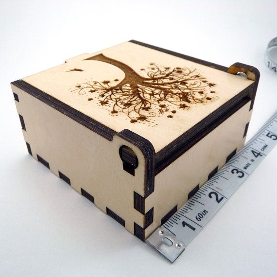 As seen in the Winter 2017 issue of Jewelry Stringing magazine! This beautiful keepsake box is perfect for storing your beloved jewelry and trinkets. The lovely, handmade, case has been designed, laser cut, and assembled by myself, and features my own artwork etched into the lid. The outside dimensions are 4 x 4 x 2. The interior dimensions are 3 1#x2F;2 x 3 1#x2F;2 x 1 1#x2F;2. Two magnets on the inside act as a clasp to hold the lid closed. Each box is made from 1#x2F;4 birch plywood...