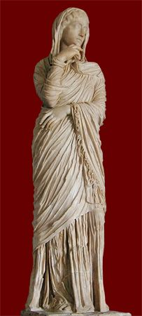 this is a statue of a palla on a roman woman. McManus, Barbara. Statue of Roman woman showing Palla. 2003. VRoma. National Endowment for the Humanities Teaching with Technology. Web. 9-26-11. http://www.vroma.org/images/mcmanus_images/matron_palla3.jpg