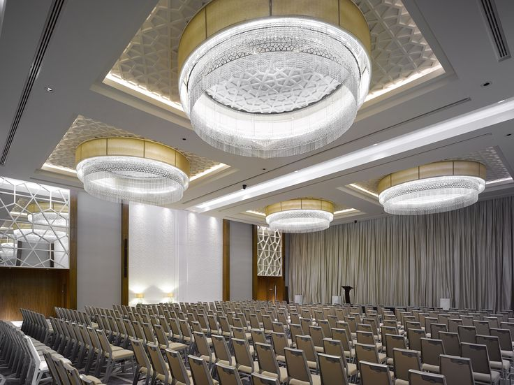 The geometric form, a symbol of the infinite, plays an integral role in the design of the Sheraton Grand hotel in Dubai. The lighting installations were developed in collaboration with LW Design Group and they are defined by a complex and controlled repetition of patterns. #light #lighting #design #hotel #hospitality