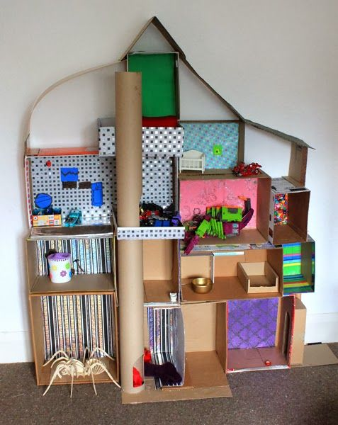 Doll house made from hot-glued cardboard boxes.