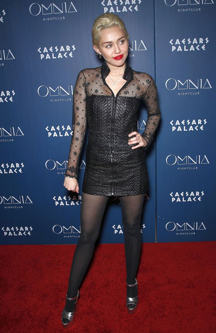 Miley Cyrus in mini leather dress and tights. Las Vegas March 22 2015