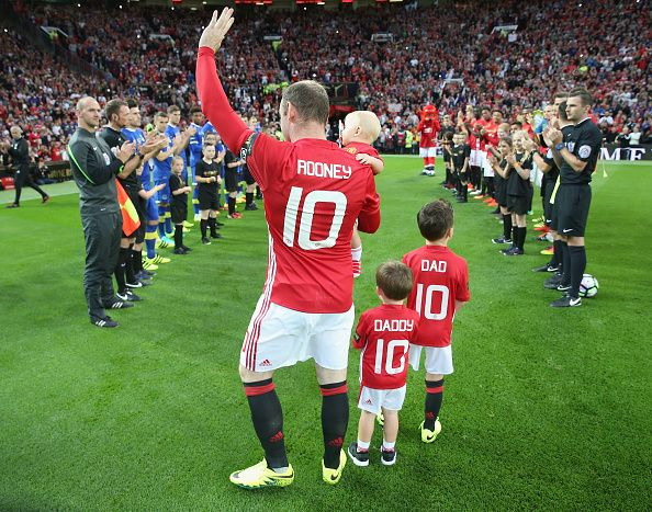 Wayne Rooney of Manchester United walks out with his sons ahead of the Wayne Rooney Testimonial match between Manchester United and…