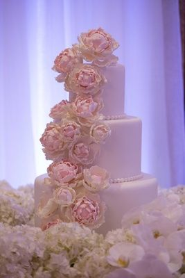 White Cake with Sugar Flower Peonies     Photography: Sakosan Photography. Read More:  http://www.insideweddings.com/weddings/armenian-wedding-with-church-ceremony-blush-white-reception/809/