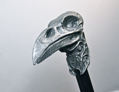 Gifted to Olaf by Georgina, the silver raven skull on this cane can be removed if necessary to reveal a sharp steel dagger, much like her own.