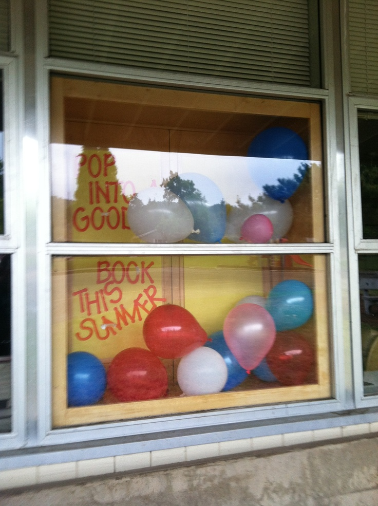 Pop into a good book this summer summer library display for Balloon decoration book