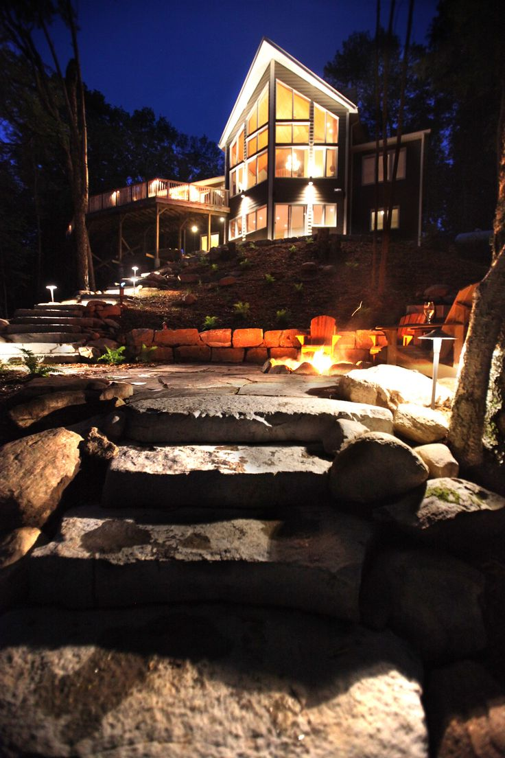 Cottage landscaping with stone stairs and fire pit