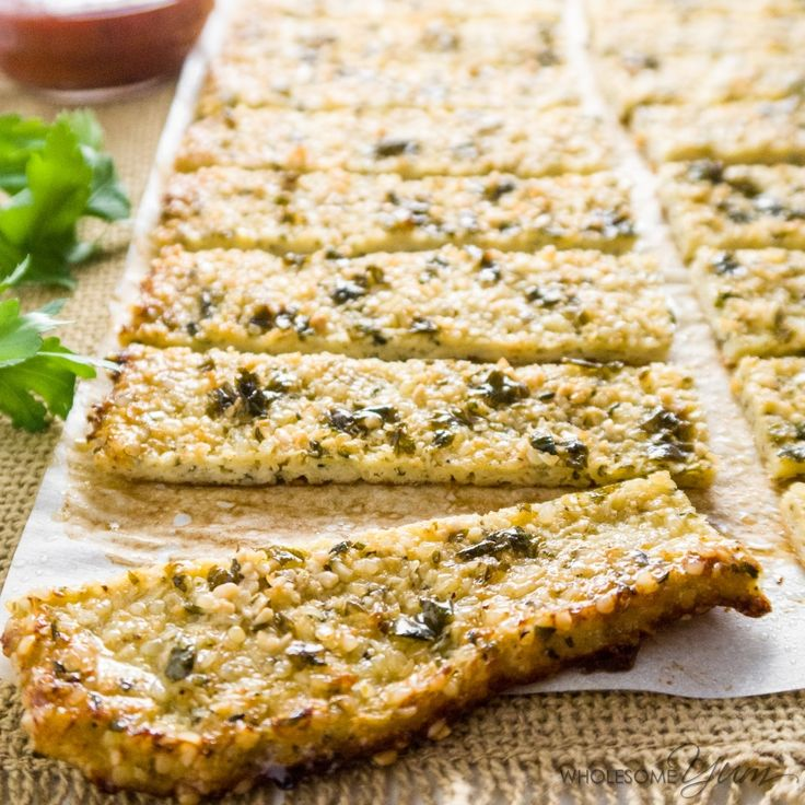 These paleo, low carb, crispy garlic butter breadsticks are made with cauliflower and hemp seeds. Gluten-free, healthy, and easy to make!