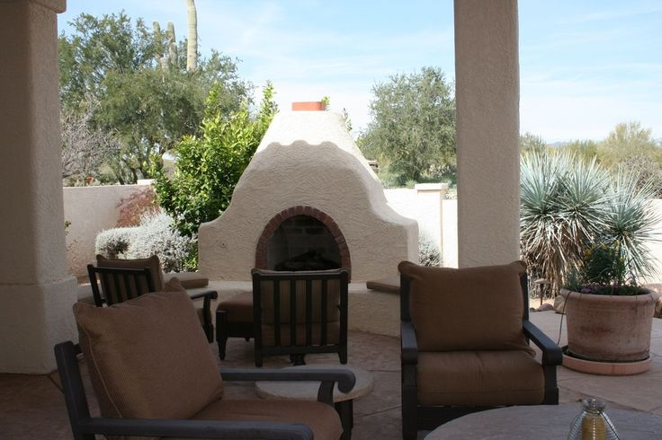 Southwestern Patio with outdoor pizza oven, exterior stone floors, Fence