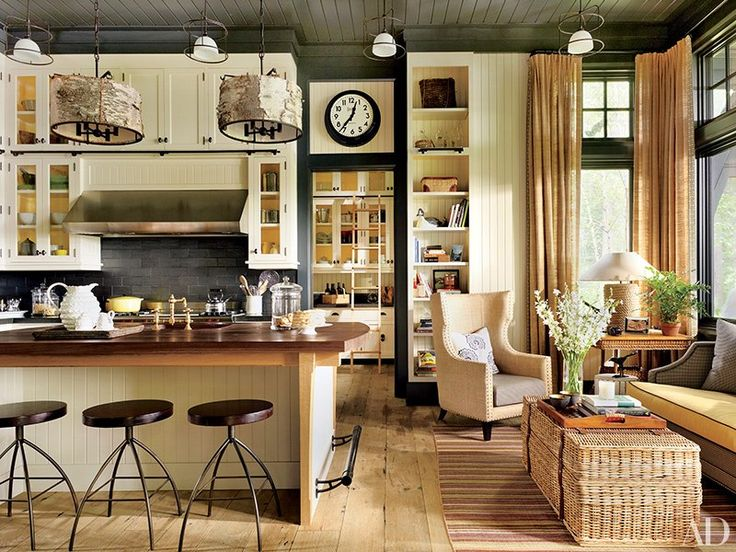 The kitchen cabinetry, designed by Thom Filicia and Shope Reno Wharton, is painted in a Farrow & Ball white