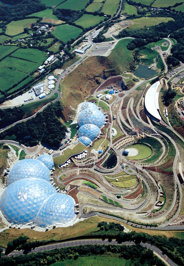 The Eden Project in Cornwall, England has biospheres with different climates for the public gardens.