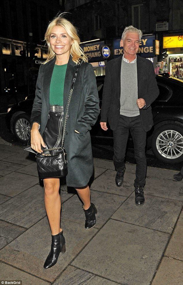 Hanging out: Holly Willoughby and her work husband Phillip Schofield were also turning out...