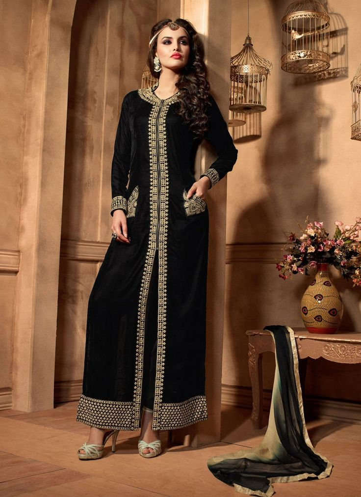 Appear stunningly appealing in such a black velvet designer suit. You are able to see some fascinating patterns performed with embroidered and resham work. Comes with matching bottom and dupatta. (Sli...
