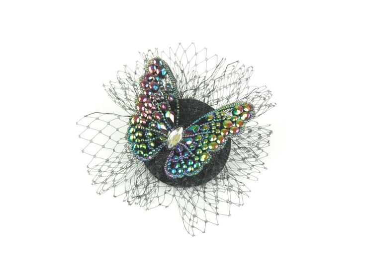 Fascinator Headpiece, Hair Accessory with Diamond Crystals Multi Coloured Butterfly and Veil, Cocktail Hat, Evening Fascinator by ElleSantos on Etsy https://www.etsy.com/uk/listing/457105320/fascinator-headpiece-hair-accessory-with