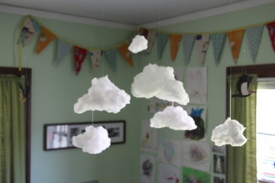 Clouds hanging from the ceiling in children's room...love...