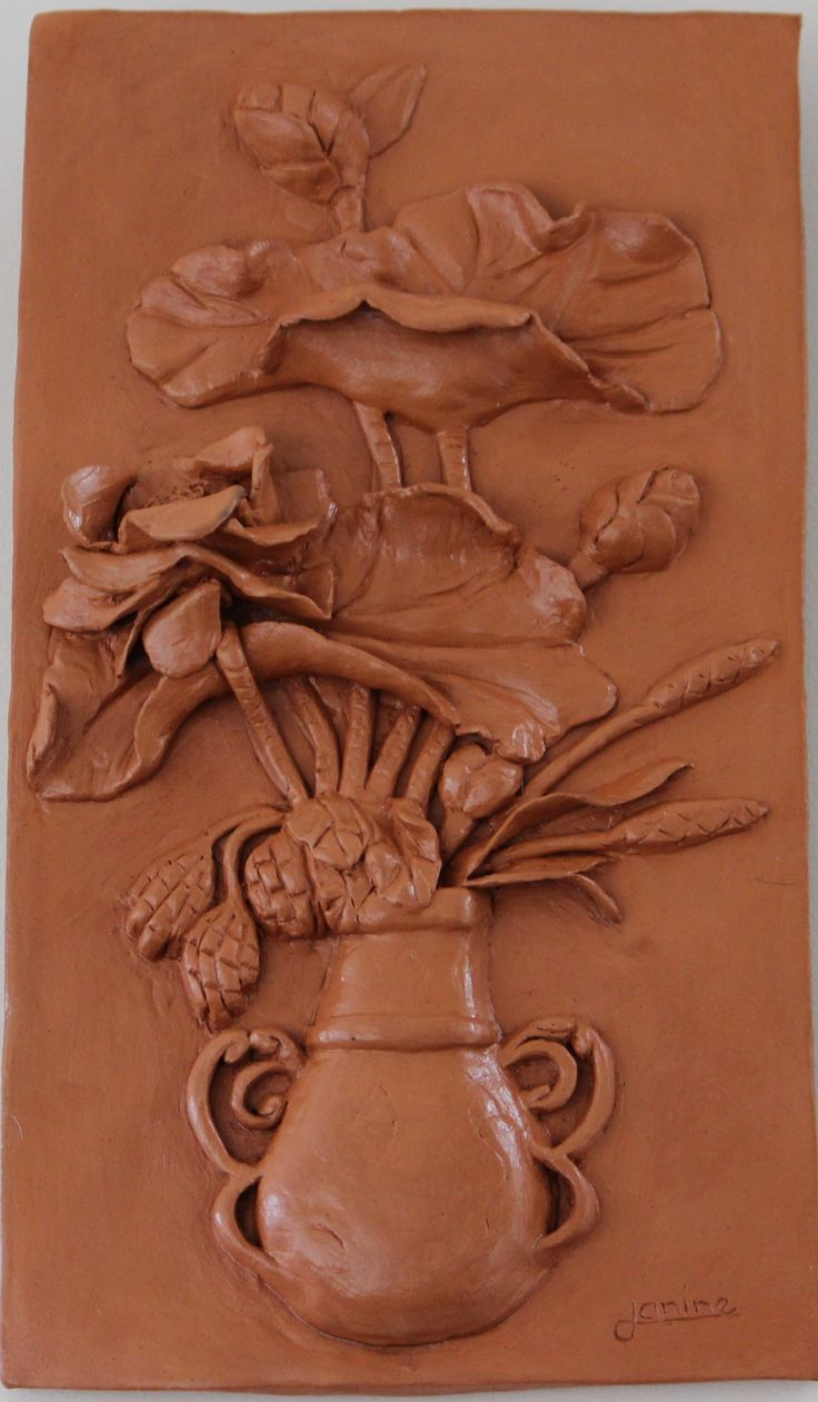 Bas relief Vase of flowers made with terracotta air dry clay.