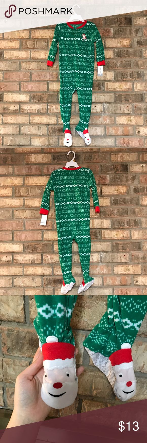 Christmas Onesie Pajamas Adorable Christmas pajamas. The feet have grips on the bottom so you don't slip. Brand new with tags!  Size 3t. Carter's Pajamas