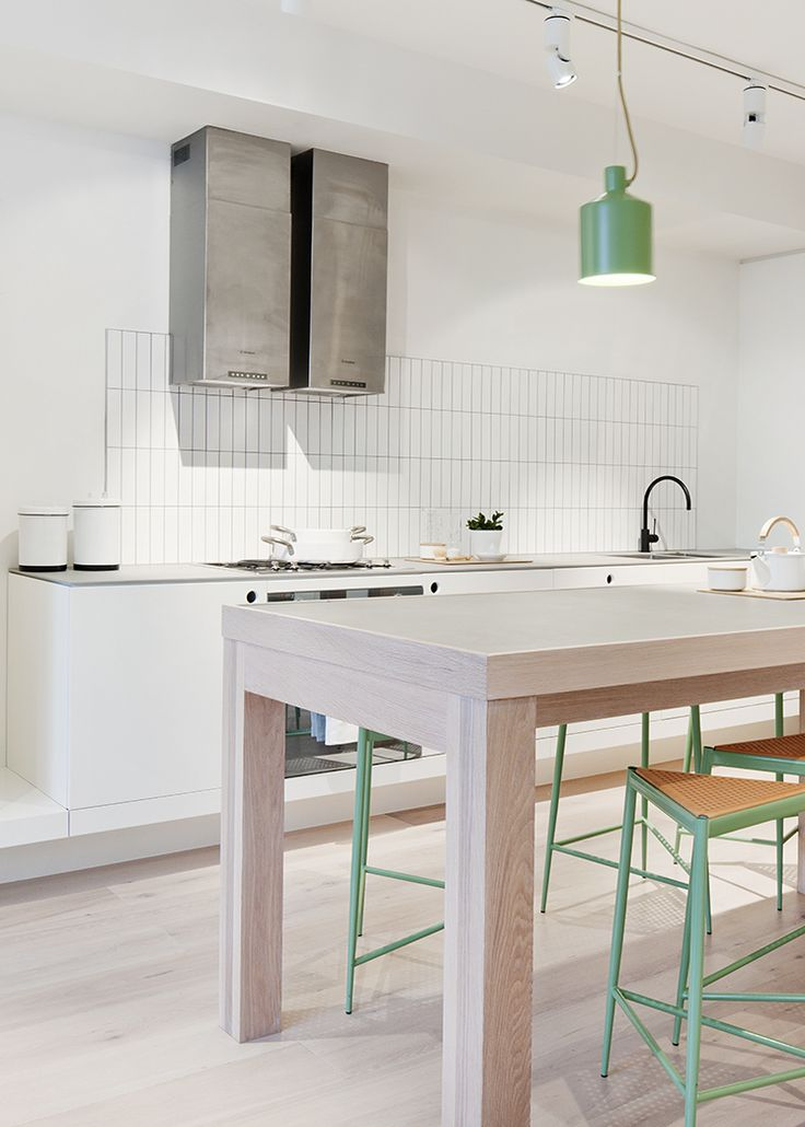 Minimal Design Elements Combine W/ A Large Table U0026 Green Stools, In This  Modern Kitchen Design.