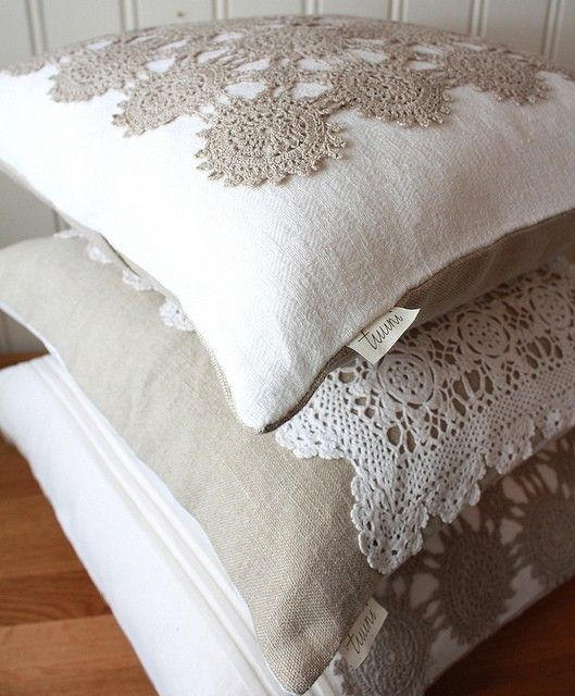 Simple burlap pillow with crocheted doiley on top.   Could do this to display grandmas treasured doileys